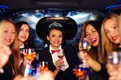 pic of hen party  - group of happy elegant women clinking glasses in limousine hen party - JPG