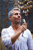 stock photo of dream-catcher  - Sexi Man in a white shirt and medieval mead horn in hand - JPG