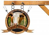 picture of food chain  - Wooden sign with head of cow forks and wooden ribbon with text Steak house - JPG