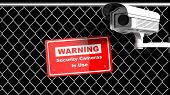image of chain link fence  - Security surveillance camera on chain - JPG