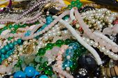 picture of stall  - A tangle of beaded necklaces and other items of jewellery for sale on a junk stall at a market in Venice, Italy. ** Note: Shallow depth of field - JPG