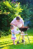 foto of grilled sausage  - Father and child grilling meat - JPG