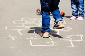 foto of playground school  - kids playing hopscotch on playground outdoors - JPG