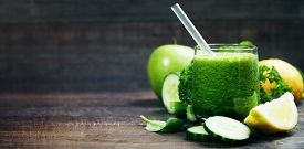 stock photo of cucumbers  - Fresh organic green smoothie with spinach - JPG