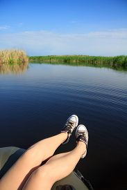stock photo of boat  - River landscape clouds in the blue sky the girl - JPG