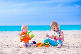 stock photo of spade  - Kids play on a beach - JPG