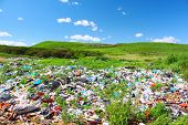 Garbage dump on green meadow