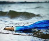 Blue bottle in water
