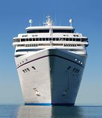 stock photo of cruise ship  - water level view of cruise ship facing the bow - JPG