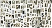 Newspaper alphabet with letters, numbers and symbols. Isolated on white