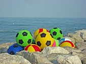 image of dick  - Dick colored footballs on the sea shore - JPG