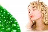Relaxed Woman And Green Leaf With Waterdrops..
