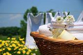 Clean towels freshly folded in wicker basket