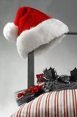 Santa hat hanging on the side of a chair  Selective B/W