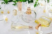 Natural Perfume Concept. Bottles Of Perfume With White Flowers On White Background. Floral Fragrance poster