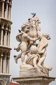 Pigeons On The La Fontana Dei Putti Or The Fountain With Angels On The Piazza Dei Miracoli In Pisa,  poster