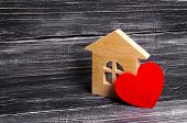 Wooden House With A Red Heart On A Dark Wooden Background. A House For Lovers, A Honeymoon. Purchase poster
