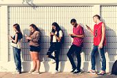 Group of young teenager friends chilling out together using smartphone social media concept poster