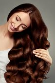 Hair. Beautiful Girl With Long Wavy And Shiny Hair. Brunette Woman With Gorgeous Curly Hairstyle. Ha poster