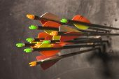 stock photo of fletching  - A selection of composite and carbon arrows which are on target and tightly grouped