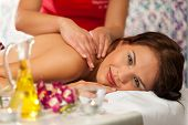 Wellness - woman getting massage in Spa; it is a traditional back massage