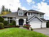Clean Home With Healthy Front Yard During Late Spring Season poster