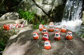pic of minos  - Traditional japanese Daruma dolls in front of a water fall at Katsuo Ji Temple in Mino Japan - JPG