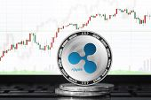 Ripple (xrp) Cryptocurrency; Physical Concept Ripple Coin On The Background Of The Chart poster