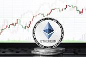 Ethereum (eth) Cryptocurrency; Physical Concept Ethereum Coin On The Background Of The Chart poster