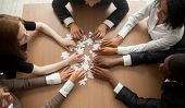 Diverse Team People Assembling Jigsaw Puzzle, Multiracial Group Of Black And White Colleagues Engagi poster