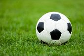 Classic Soccer Football Ball On Soccer Pitch. Green Grass Soccer Field. Soccer Turf In The Backgroun poster