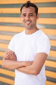 Happy Indian Guy Posing With Arms Crossed And Smiling At Camera. Portrait Of Young Yoga Practitioner poster