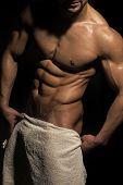 Athletic Bodybuilder Man On Black Background. Coach Sportsman With Bare Chest, Shower. Sport And Wor poster
