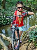 Bicycle teen with ladies bikes in summer park. Womens road bike for running on nature. Teenager girl poster