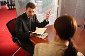 image of motivation talk  - business man and woman talking in the office