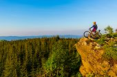Mountain biking woman riding on bike in summer mountains forest landscape. Woman cycling MTB flow tr poster