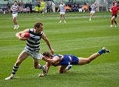 MELBOURNE - SEPTEMBER 24 : James Kelly (L) evades a tackle from Andrew Embley during Geelong's preli