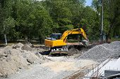 Big Excavator On New Construction Site. Excavator Loader Machine During Earthmoving Works Outdoors A poster