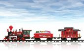 picture of chug  - A colorful holiday Christmas train in the snow with a cloudy sky - JPG
