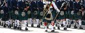 picture of bagpiper  - Kilted Bagpipe players Calgary Stampede Parade Calgary Alberta - JPG