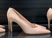 Classic, Graceful Womens High-heeled Shoes. Bright Womens Shoes On A Dark Background In A Shoe Sto poster