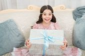 Filled With Surprise. Surprised Child. Happy Kid With Gift Surprise. Little Girl Hold Present Box. R poster