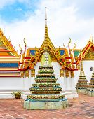 Wat Pho Temple In Bangkok City, Thailand. View Of Pagoda And Stupa In Famous Ancient Temple. Religio poster