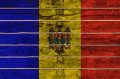 National Flag  Of Moldova On A Wooden Wall Background. The Concept Of National Pride And A Symbol Of poster