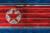 National Flag  Of North Korea On A Wooden Wall Background. The Concept Of National Pride And A Symbo poster