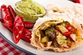 pic of mexican food  - traditional mexican chicken and beef fajitas with guacamole - JPG