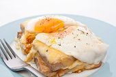 Serving of Croque Madame (Ham, Cheese, Bechamel Sauce and Egg Traditional French Toasted Sandwich) c