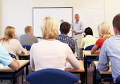 stock photo of tutor  - Senior tutor teaching class - JPG
