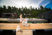 Young Cute Guy Makes A Marriage Proposal To His Beloved Girl, Standing On His Knee On A Wooden Pier. poster