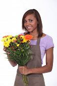 Young florist with bouquet